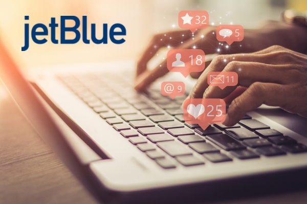 A person typing on a laptop with social media icons overlaid on her fingers. Plus JetBlue logo