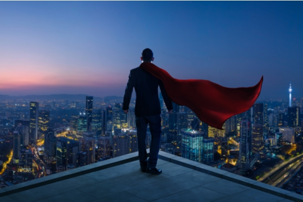 A superhero looking over a city skyline